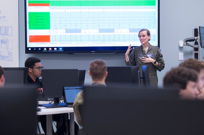 U.S. Air Force Lt. Col. Vanessa Cox, chief of scheduling with the 116th Operations Support Squadron, Georgia Air National Guard, briefs Mercer University upperclassmen to explain scheduling processes of the E-8C Joint STARS at the Mercer campus in Macon, Ga., Oct. 8, 2019. The students from the computer science department worked on an innovation project to help reform the way JSTARS scheduling is run. (U.S. Air National Guard photo by Tech. Sgt. Nancy Goldberger.)