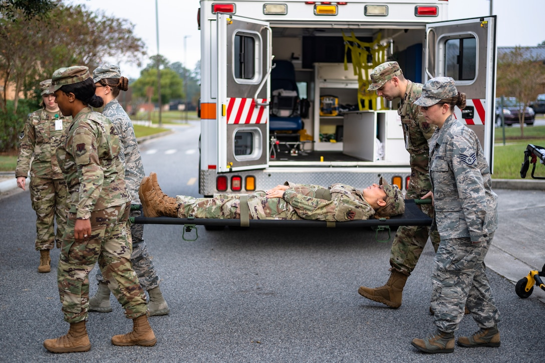 Airmen with the 23d Medical Group practice horizontal litter-carry movements during training Oct. 25, 2019, at Moody Air Force Base, Ga. The 23d MDG conducted the training in preparation for the upcoming Thunder Over South Georgia Open House. Airmen practiced litter-carry movements and commands to ensure they have the appropriate skills in the case of an emergency. (U.S. Air Force photo by Airman 1st Class Taryn Butler)