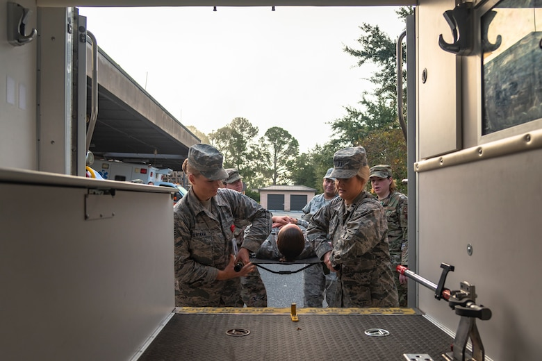 Airmen with the 23d Medical Group (MDG) place a simulated patient in an ambulance during litter-carry training Oct. 25, 2019, at Moody Air Force Base, Ga. The 23d MDG conducted the training in preparation for the upcoming Thunder Over South Georgia Open House. Airmen practiced litter-carry movements and commands to ensure they have the appropriate skills in the case of an emergency. (U.S. Air Force photo by Airman 1st Class Taryn Butler)