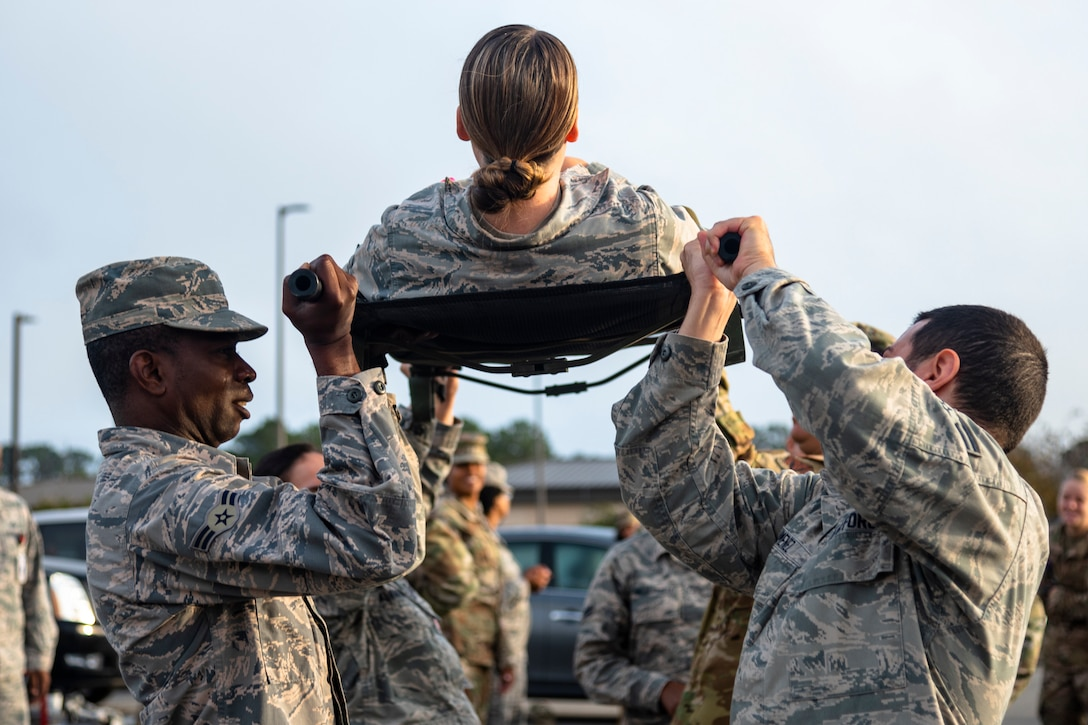 Airmen with the 23d Medical Group (MDG) practice lateral litter-carry movements during training Oct. 25, 2019, at Moody Air Force Base, Ga. The 23d MDG conducted the training in preparation for the upcoming Thunder Over South Georgia Open House. Airmen practiced litter-carry movements and commands to ensure they have the appropriate skills in the case of an emergency. (U.S. Air Force photo by Airman 1st Class Taryn Butler)