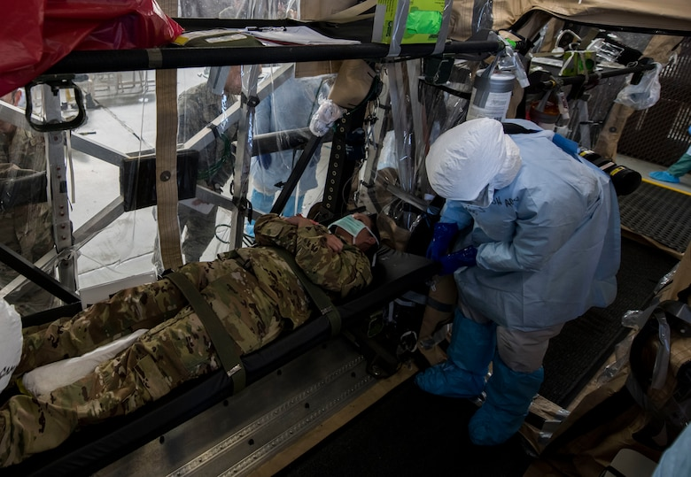 Staff Sgt. Lee Nembhard, an aeromedical evacuation technician assigned to the 375th Aeromedical Evacuation Squadron from Scott Air Force Base, Ill., fastens a litter to a Transport Isolation System during a TIS training exercise at Joint Base Charleston, S.C., October 23, 2019. The TIS is a device used to transport Ebola patients, either by C-17 Globemaster III or C-130 Hercules, while preventing the spread of disease to medical personnel and aircrews until the patient can get to one of three designated hospitals in the United States that can treat Ebola patients. JB Charleston is currently the only military installation with a TIS. The TIS mission is a sub-specialty of the aeromedical evacuation mission which requires frequent training to maintain readiness.