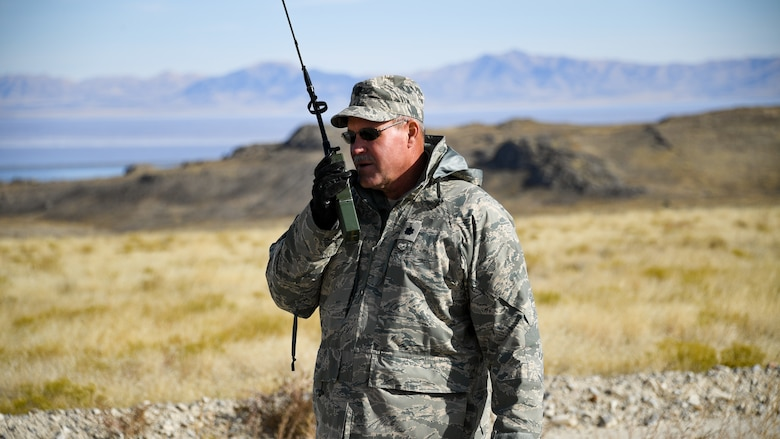 Lt. Col. Don Teig with the Reserve 757th Airlift Squadron communicates with an airbourne C-130 Hercules crew during an aerial spray operation at the Utah Test and Training Range on Oct. 24, 2019.