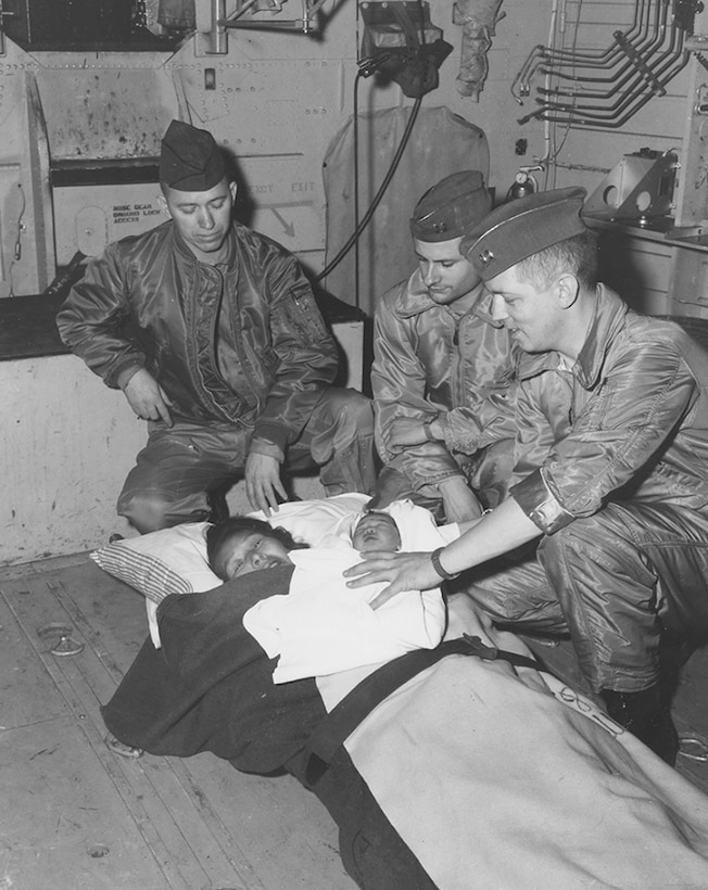 An Air Force doctor from Elmendorf Air Force Base in Anchorage, Alaska, delivered a woman's son during a mercy flight on March 17, 1965. The C-130's crew, from the 5017th Operations Squadron, assisted in the delivery. (Courtesy photo)