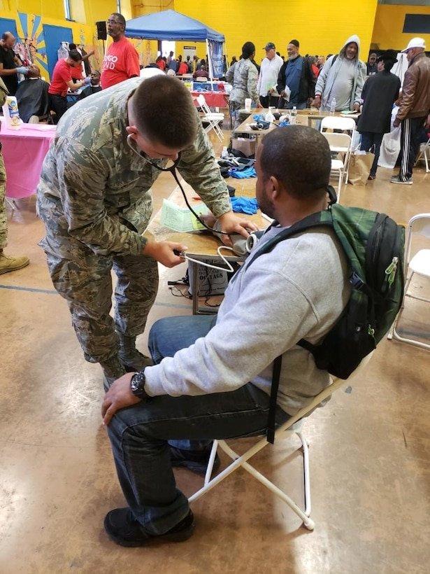 Airman Matthew Constantino, a medical technician, with the 108th Medical Group, provides blood pressure testing to a veteran at the John F. Kennedy pool and recreation center in Newark, N.J., Oct. 12, 2019. Several Air National Guard and National Guard units, emergency medical technicians and Veterans Affairs nurses, volunteered their services at the free health screening initiative to approximately 200 veterans. The event was coordinated by GI Go Fund. (Photos courtesy of Senior Airman Amychristy Amakihe)