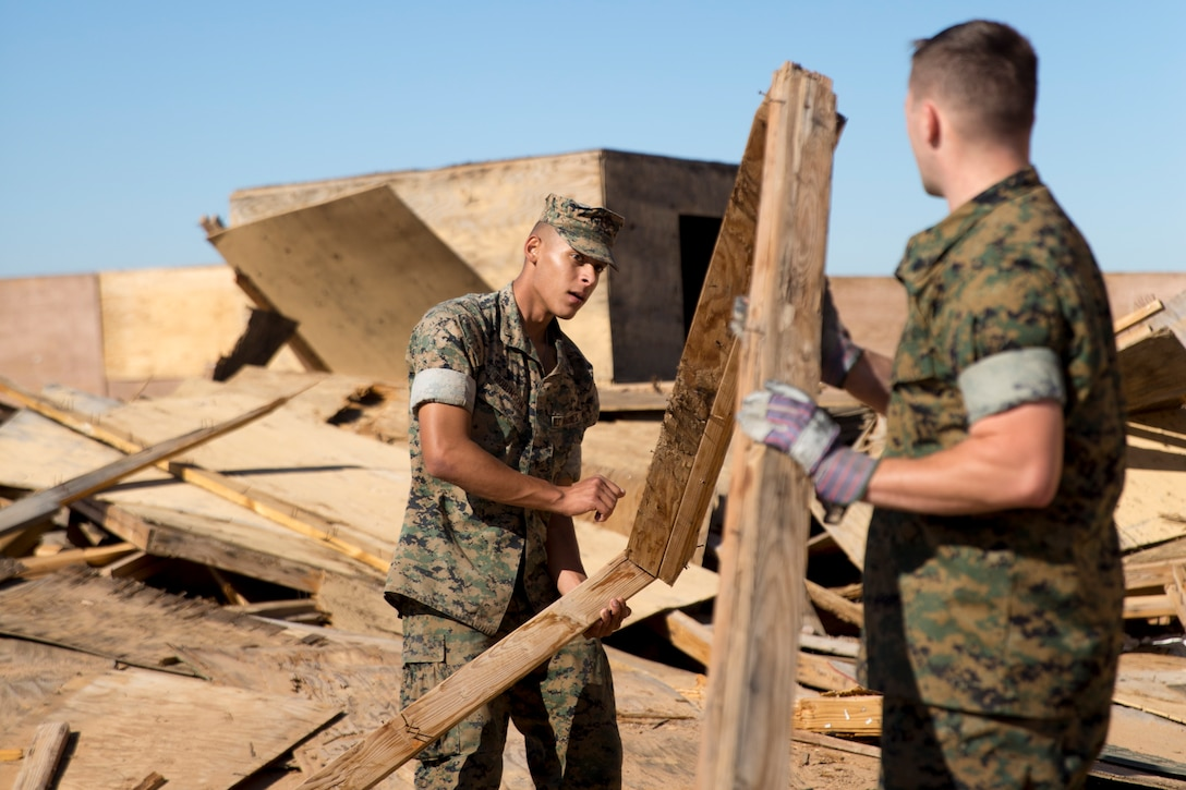 U.S. Marine Corps Pfc. Myron W. Robinson, military police with Marine Corps Air Station Yuma, helps remove an old structure as part of a cleanup effort Oct. 22, 2019 on the Barry M. Goldwater Range West. The BMGR consists of about 1.7 million acres of land and MCAS Yuma manages over 650,000 of those acres.