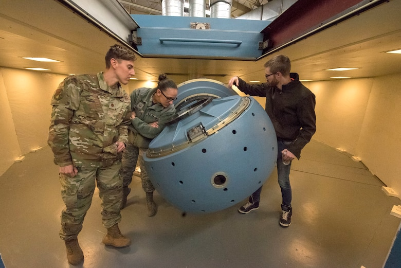 Sean Abrahamson, 746th Test Squadron test manager, shows event patrons a centrifuge used for testing, Oct. 25, 2019, on Holloman Air Force Base, N.M. The 746th TS centrifuge testing uses multi-axis test tables to check inertial performance on navigations systems prior to testing in aircraft. (U.S. Air Force photo by Staff Sgt. Christine Groening)