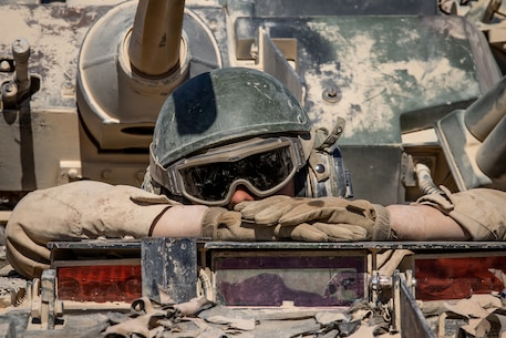 A U.S. Marine with the commanding general's JUMP Platoon, 2nd Light Armored Reconnaissance Battalion, 2nd Marine Division (2d MARDIV) prepares to conduct a convoy at Camp Wilson, Marine Corps Air Ground Combat Center, Twentynine Palms, California, Oct. 26, 2019. The JUMP Platoon Marines are tasked to provide security and transportation for the commanding general throughout the MAGTF Warfighting Exercise (MWX) 1-20. MWX is set to be the largest exercise conducted by the 2d MARDIV in several decades. (U.S. Marine Corps photo by Pfc. Patrick King)