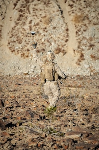 U.S. Marine Corps Cpl. Gilbert Barrett with 1st Battalion, 6th Marine Regiment, operates the Instant Eye Small Unmanned Air System at Range 230 for Integrated Training Exercise (ITX) 1-20 on Marine Corps Air Ground Combat Center, Twentynine Palms, California, Oct. 23, 2019. The purpose of ITX 1-20 is to create a challenging, realistic training environment that produces combat-ready forces capable of operating as an integrated Marine Air Ground Task Force. (U.S. Marine Corps photo by Cpl. Timothy J. Lutz)