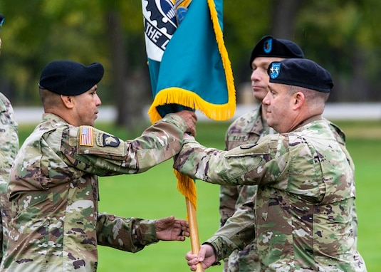 Command Sgt. Maj. Marco Torres receives the ASC colors from Maj. Gen. Steven Shapiro, commanding general of the U.S. Army Sustainment Command.