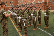 The Marines hone their rifle drill during Ceremonial Drill School.