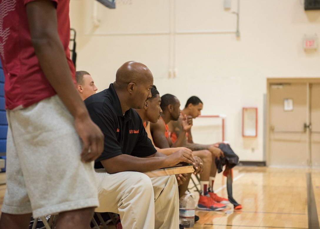 Tech. Sgt. Sean Collin, 726th Air Control Squadron NCOIC of weapons and tactics, supervises a team during a basketball game, Aug. 25, 2019, at Mountain Home Air Force Base, Idaho. The Gunfighters faced off with a team made of college players and players who've participated in the National Basketball Association's development league. (U.S. Air Force photo by Senior Airman Tyrell Hall)