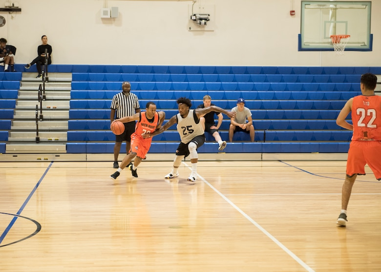 Players for the Mountain Home Air Force Base Gunfighters play against a local basketball team, Aug. 25, 2019, at Mountain Home Air Force Base, Idaho. The Gunfighters faced off with a team made of college players and players who've participated in the National Basketball Association's development league. (U.S. Air Force photo by Senior Airman Tyrell Hall)