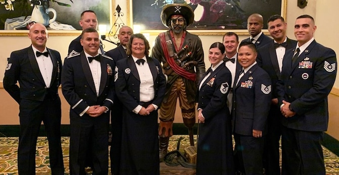 433rd TRS members pose for a photo during the Oct. 17 Military Training Instructor Association Banquet at Joint Base San Antonio-Lackland, Texas.  Pictured back row - left to right: Tech. Sgt. Nicholas Walker, Senior Master Sgt. Jason Wagner, Master Sgt. Mike Hernandez, Master Sgt. Kevin Carmony, Tech. Sgt. Davon Anderson, Master Sgt. Hugo Escobedo; Front row – left to right: 433rd TRS Commander Lt. Col. Christopher Victoria, 433rd TRS Superintendent Chief Master Sgt. Tamara Strange, Master Sgt. Nikole Rhodes, Tech. Sgt. Christina Rapolla, Tech. Sgt. Sammuel Alanis. Holding down center stage is the 433rd TRS' beloved Raider mascot. Rapolla was named the Reserve MTI of the Year, Escobedo was the squadron's MTIA President's Award winner, and Alanis was the squadron's Rookie of the Year. (U.S. Air Force photo)