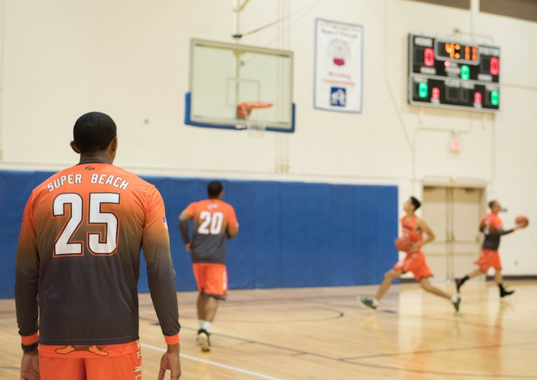 Airman 1st Class Alex Beachum, 366th Logistics Readiness Squadron vehicle operator, participates in a warm up before a basketball game, Aug. 25, 2019, at Mountain Home Air Force Base, Idaho. The Gunfighters faced off with a team made of college players and players who've participated in the National Basketball Association's development league. (U.S. Air Force photo by Senior Airman Tyrell Hall)
