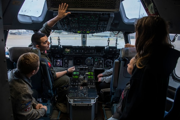 U.S. Air Force Capt. Dan Godshalk, a pilot assigned to the 58th Airlift Squadron, shows the controls of a C-17 Globemaster III to students of the STARBASE program