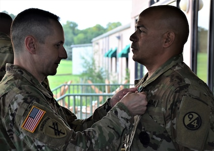 Brig. Gen. Stephen Iacovelli (left), 94th Training Division-Force Sustainment commanding general, presents Sgt. 1st Class Raul Nieves (right), 5/80th Battalion heating, ventilation, and air conditioning instructor, 3rd Ordnance Brigade, 94th TD-FS, with the Army Commendation Medal for earning top honors at the 94th TD-FS Instructor of the Year Competition Aug. 17, 2019, at Joint Base McGuire-Dix-Lakehurst, New Jersey.
