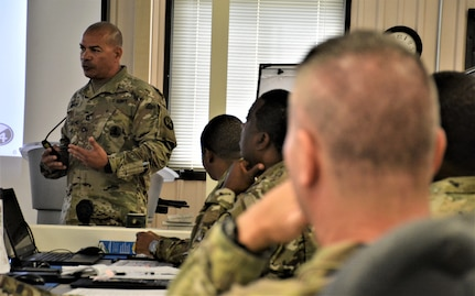 Sgt. 1st Class Raul Nieves (left), 5/80th Battalion heating, ventilation, and air conditioning instructor, 3rd Ordnance Brigade, 94th Training Division - Force Sustainment, gives his block of instruction on suicide prevention during the 94th Training Division Instructor of the Year Competition Aug. 15-17, 2019, at Joint Base McGuire-Dix-Lakehurst, New Jersey.