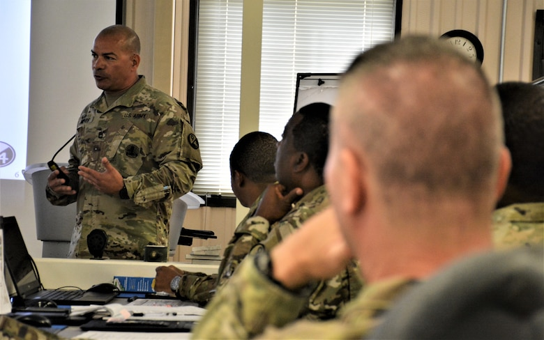 Sgt. 1st Class Raul Nieves (left), 5/80th Battalion heating, ventilation, and air conditioning instructor, 3rd Ordnance Brigade, 94th Training Division - Force Sustainment, gives his block of instruction on suicide prevention during the 94th Training Division Instructor of the Year Competition Aug. 15-17, 2019, at Joint Base McGuire-Dix-Lakehurst, New Jersey.  As the overall competition winner, Nieves was also presented with a trophy, awarded the Army Commendation Medal, offered a slot to attend the Army Air Assault School, and will automatically advance to compete in the upcoming 80th Training Command IOY Competition Oct. 23-27, 2019. (Photo by Maj. Ebony Gay, 94th TD-FS Public Affairs Office)