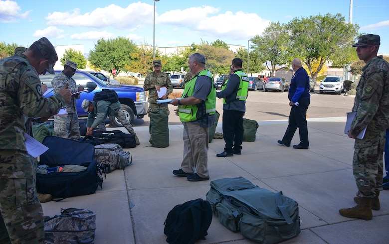 Members of the U.S. Air Force Inspector General's Office inspect baggage during a mass deployment as part of exercise Global Thunder 20 at Kirtland Air Force Base, N.M., Oct. 24, 2019. Large-scale exercises, like Global Thunder, involve extensive planning and coordination to provide unique training for assigned units and allies. (U.S. Air Force photo by Staff Sgt. Kimberly Nagle)