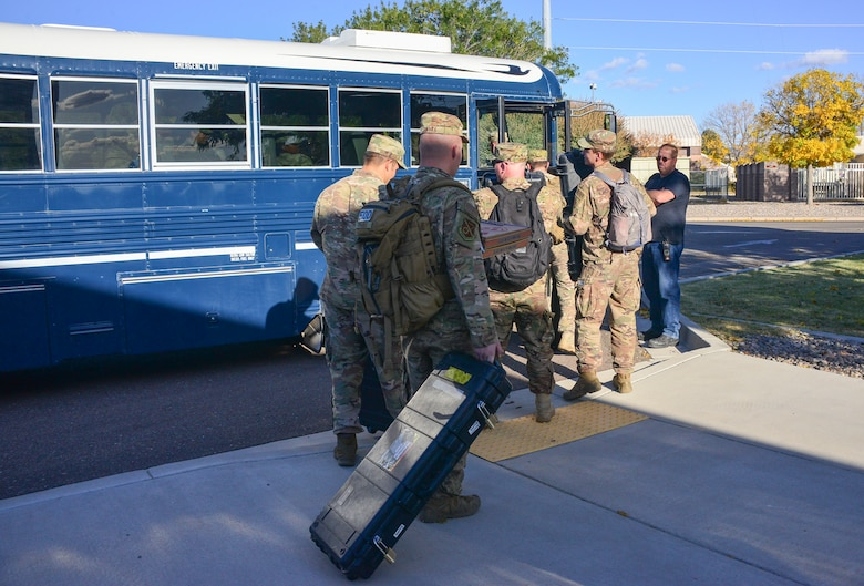 Members of Team Kirtland load onto the bus to deploy during exercise Global Thunder 20 at Kirtland Air Force Base, N.M., Oct. 24, 2019. Global Thunder is an annual nuclear command and control exercise that provides training opportunities for all of U.S. Strategic Command's mission areas, tests joint and field training operations, and has a specific focus on nuclear readiness. (U.S. Air Force photo by Staff Sgt. Kimberly Nagle)