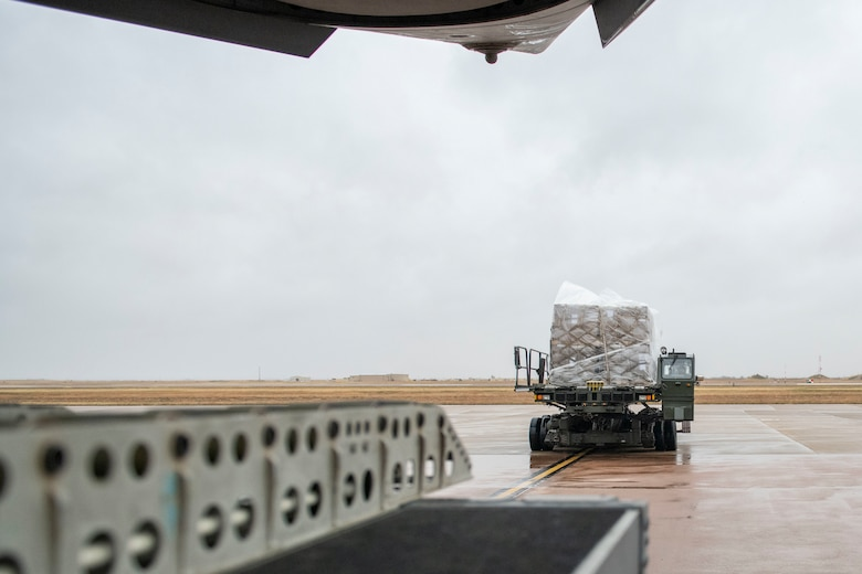 Rice and soy meals are flown to Honduras on a C-17.