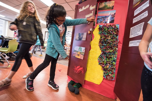 Ava Perez, 11, shows off the door for her pre-teen class at the Youth Center for Red Ribbon Week Oct. 23, 2019, at Travis Air Force Base, California. The Youth Center held a contest where students and staff decorated doors with various themes on how to be aware of the effects of drugs. Red Ribbon Week is a drug prevention, awareness and educational program in conjunction with the Drug Demand Reduction Program within the Department of Defense. (U.S. Air Force Photo by Nicholas Pilch)