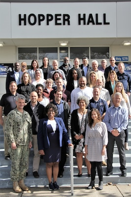 IMAGE: VIRGINIA BEACH, Va. (Oct. 22, 2019) – Navy safety and occupational health and environmental managers from 10 Naval Warfare Center divisions, Naval Air Station Oceana Regional Safety Office, and the Navy Safety Center, are pictured at the Naval Warfare Center's Safety and Environmental Face-to-Face Symposium. The managers shared innovative ideas, trends, and information impacting safety, occupational health, and environmental protection at the event hosted by Naval Surface Warfare Center Dahlgren Division Dam Neck Activity.  (U.S. Navy photo by George Bieber/Released)