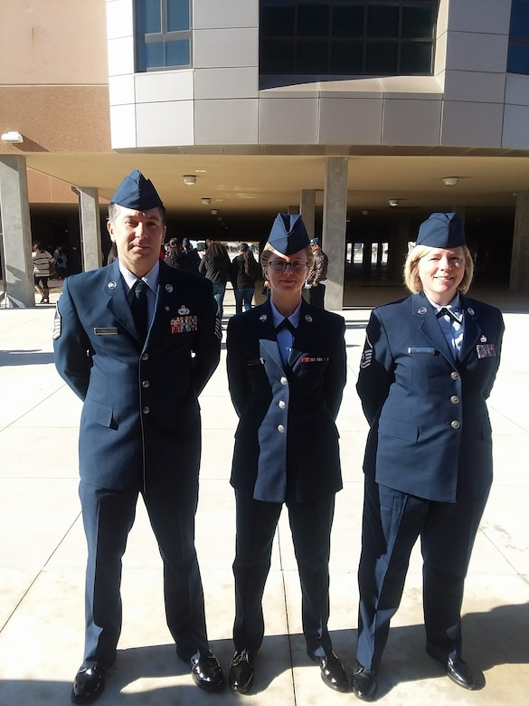 Retired Master Sgt. Aaron Abercrombie, 437th Aircraft Maintenance Squadron production expediter, Airman 1st Class Hanah Abercrombie, 30th Space Wing photojournalist, and Master Sgt. Ivy Abercrombie, 315th Aircraft Maintenance Squadron assistant first sergeant, pose for a photo after Hanah's basic training graduation ceremony December 2017, at Joint Base San Antonio Lackaland, Texas. Hanah joined the Air Force, following in the footsteps of her parents, with hopes to positively impact those around her. (Courtesy photo)
