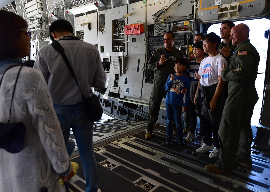 Members of the Pacific Air Forces C-17 Demonstration Team at Joint Base Pearl Harbor-Hickam, Hawaii, pose for a photo during the Seoul International Aerospace and Defense Exhibition 2019 at the Seoul Airport, Republic of Korea, October 19, 2019.