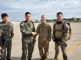 United States Air Force Captain Emily Barkemeyer stands alongside Republic of Korea allies.