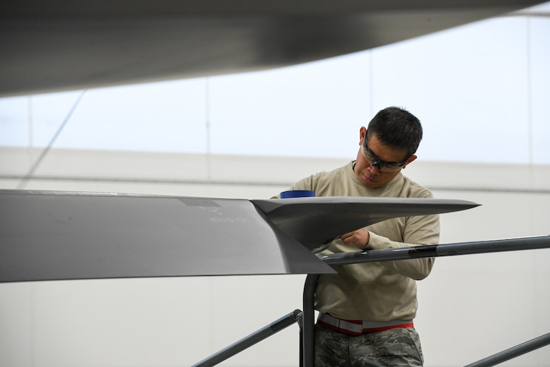 Tech. Sgt. Edmundo Pena, 388th Maintenance Squadron Fabrication Flight, performs a low observable restoration on a F-35A Lightning II wing tip at Hill Air Force Base, Utah, Oct. 3, 2019. The radar aborbent surface coatings on the F-35 help the aircraft survive in enemy air space. (U.S. Air Force photo by R. Nial Bradshaw)