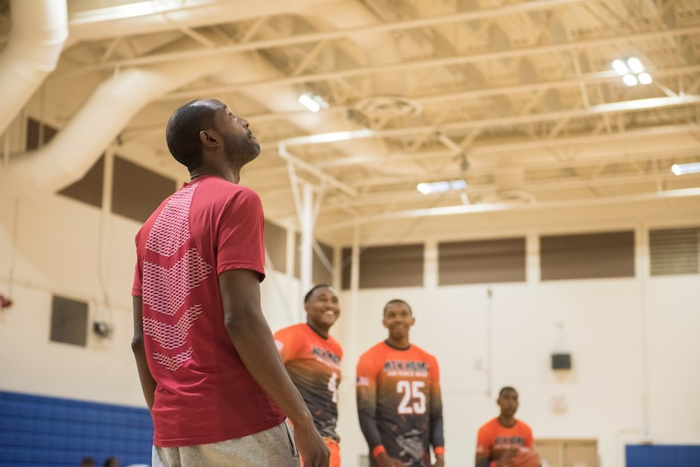Airman 1st Class Brandon Taylor, 366th Maintenance Squadron aerospace ground equipment range, supervises a basketball team while they practice at a game, Aug. 25, 2019, at Mountain Home Air Force Base, Idaho. Taylor coached the Gunfighters during a game where they faced off with a team made of college players and players who've participated in the National Basketball Association's development league. (U.S. Air Force photo by Senior Airman Tyrell Hall)