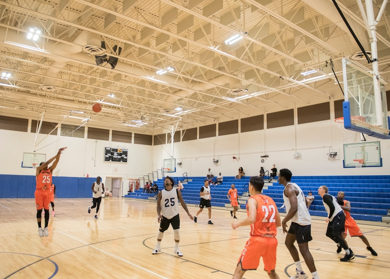 Basketball players for the Mountain Home Air Force Base Gunfighters play against a local team, Aug. 25, 2019, at Mountain Home Air Force Base, Idaho. The Gunfighters faced off with a team made of college players and players who've participated in the National Basketball Association's development league. (U.S. Air Force photo by Senior Airman Tyrell Hall)