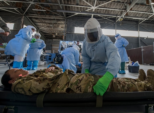 Staff Sgt. Lee Nembhard, an aeromedical evacuation technician assigned to the 375th Aeromedical Evacuation Squadron from Scott Air Force Base, Ill., straps a simulated Ebola patient to a litter during a Transport Isolation System training exercise at Joint Base Charleston, S.C., October 23, 2019. The TIS is a device used to transport Ebola patients, either by C-17 Globemaster III or C-130 Hercules, while preventing the spread of disease to medical personnel and aircrews until the patient can get to one of three designated hospitals in the United States that can treat Ebola patients. JB Charleston is currently the only military installation with a TIS. The TIS mission is a sub-specialty of the aeromedical evacuation mission which requires frequent training to maintain readiness.