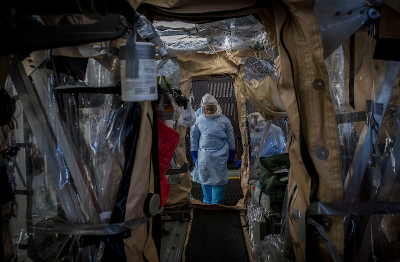 Staff Sgt. Clinton Campbell, an aeromedical evacuation technician assigned to the 375th Aeromedical Evacuation Squadron from Scott Air Force Base, Ill., carries a simulated Ebola patient on a litter into the Transport Isolation System during a Transport Isolation System training exercise at Joint Base Charleston, S.C., October 23, 2019. The TIS is a device used to transport Ebola patients, either by C-17 Globemaster III or C-130 Hercules, while preventing the spread of disease to medical personnel and aircrews until the patient can get to one of three designated hospitals in the United States that can treat Ebola patients. JB Charleston is currently the only military installation with a TIS. The TIS mission is a sub-specialty of the aeromedical evacuation mission which requires frequent training to maintain readiness.