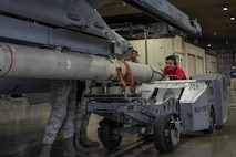 """U.S. Air Force Airman 1st Class Adam Randles, a 13th Aircraft Maintenance Unit load crew member, operates an MJ-1 standard lift truck during the third quarter load competition at Misawa Air Base, Japan, Oct. 25, 2019. The truck transports, loads and unloads munitions and supplies, and is able to lift approximately 3,000 pounds. The MJ-1, also known as a """"jammer"""", serves as the standard U. S. Air Force bomb loading vehicle since the 1950s. (U.S. Air Force photo by Airman 1st Class China M. Shock)"""
