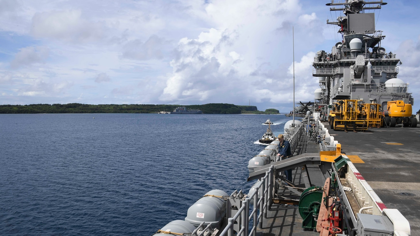 APRA HARBOR, GUAM (Oct. 30 2019) The amphibious assault ship USS Boxer (LHD 4) transits Apra Harbor. The Boxer Amphibious Ready Group (ARG) and 11th Marine Expeditionary Unit (MEU) are deployed to the U.S. 7th Fleet area of operations to support regional stability, reassure partners and allies, and maintain a presence to respond to any crisis ranging from humanitarian assistance to contingency operations.