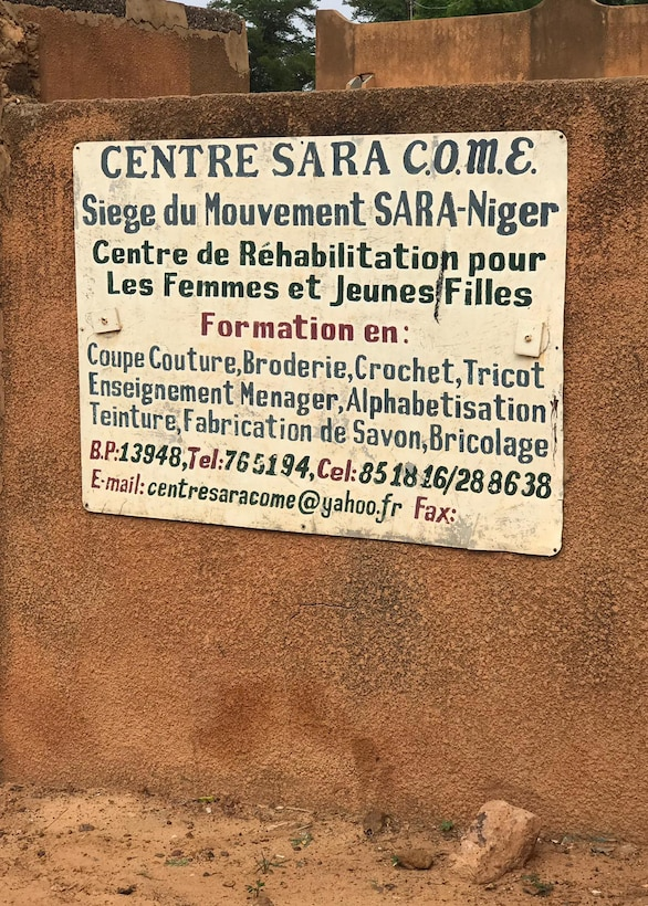 Pictured is the sign for the Sara-Niger Rehabilitation Center Movement for Women and Girls in Niamey, Niger. From Sept. 21 to Oct. 14, 2019, Airmen deployed to Nigerien Air Base 101 and U.S. Embassy personnel renovated the local women's vocational school that teaches local women techniques for making clothing, providing them with a profession and a source of income. (Courtesy Photo)