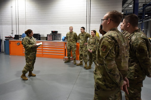 Tech. Sgt. Lorena Hodge, 48th Munitions Squadron armament support section chief, talks to her troops during an afternoon meeting at Royal Air Force Lakenheath, England, Oct. 11, 2019. Hodge was preparing for deployment and wanted to connect with her team before her departure. (U.S. Air Force photo by Airman 1st Class Jessi L. Monte)