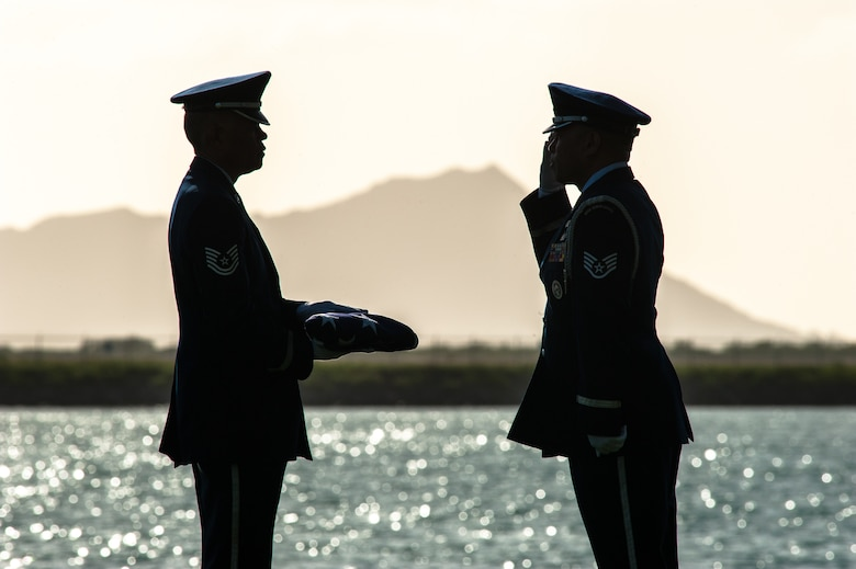 Tech. Sgt. Mark Crabbe and Staff Sgt. Darrell Bactad, 204th Airlift Squadron information managers, practice Honor Guard ceremonial movements Oct. 4, 2019, at Joint Base Pearl Harbor-Hickam, Hawaii. The two friends have performed military ceremonies side-by-side in the Hawaii Air National Guard Honor Guard team since the early 2000s. Crabbe became an honor guardsmen in 2001 and Bactad joined in 1999, when the unit was established. (U.S. Air National Guard photo by Senior Airman John Linzmeier)