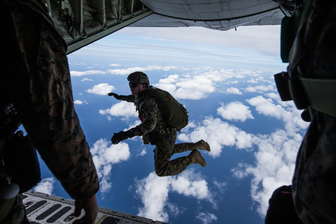 U.S. Marines with 3rd Reconnaissance Battalion, 3rd Marine Division conduct parachute operations by jumping out of a KC-130 Hercules on Ie Shima, Okinawa, Japan, Oct. 28-30, 2019.  This combined training included Marines from 3rd Transportation Support Battalion, 3rd Marine Logistics Group, as well as support from Marine Aerial Refueler Transport Squadron 152 and Marine Light Attack Helicopter Squadron 169, 1st Marine Aircraft Wing.  This military training ensures the Marines from III Marine Expeditionary Force are constantly trained and ready to provide aerial delivery of personnel or equipment wherever needed, quickly and effectively.  The U.S. military training conducted in the INDOPACIFIC area also provides security to the region, to include our Japanese Allies.