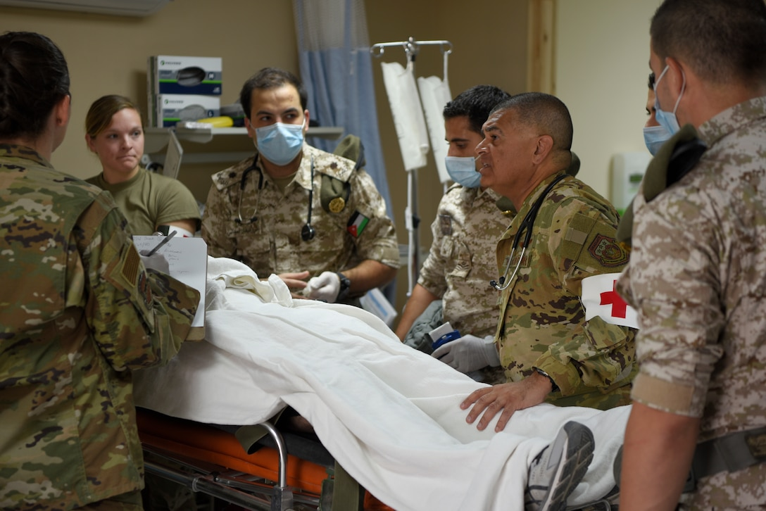 U.S. Air Force and Royal Jordanian Air Force medical teams triage a patient with simulated injuries during a mass casualty exercise at the 332d Air Expeditionary Wing, Oct. 16, 2019. Teams trained together to share techniques and break language barriers to operate as a unified multi-lateral team. (U.S. Air Force photo by Tech. Sgt. Andrew Satran)