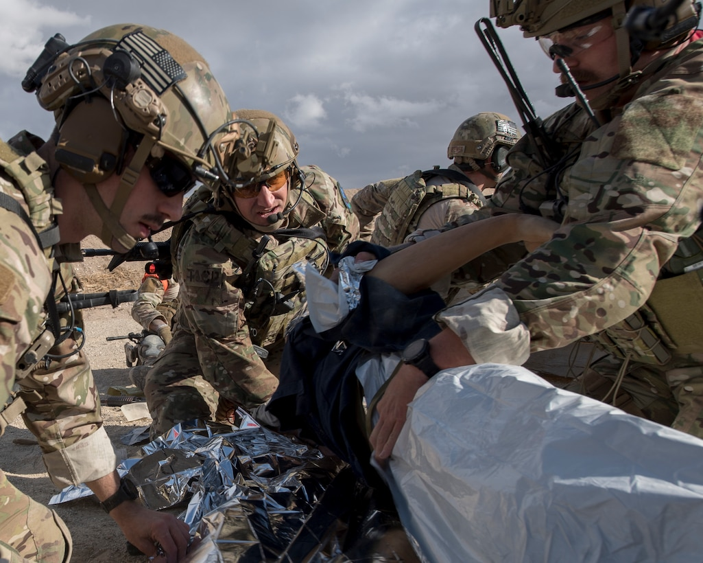 Special warfare Airmen from the 124th Air Support Operations Squadron provide Tactical Combat Casualty Care to training mannequin during a live-fire exercise near Gowen Field, Boise, Idaho, Oct. 17, 2019. The training mannequin was controlled by tablet to provide realistic input for the TACP Airmen. (U.S. Air National Guard photo by Senior Master Sgt. Joshua C. Allmaras)