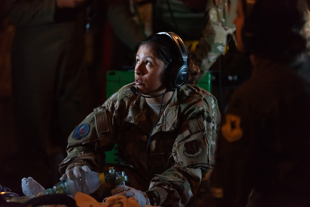U.S. Air Force Senior Airman Erica Escalante, 18th Aeromedical Evacuation Squadron technician, simulates life-saving procedures to a training mannequin onboard a KC-135 Stratotanker during an exercise at Kadena Air Base, Japan, Oct. 8, 2019. The 18th AES maintains a forward operating presence and supports medical contingencies in a free-and-open Indo-Pacific. (U.S. Air Force photo by Senior Airman Matthew Seefeldt)