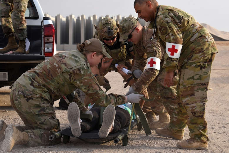 Airmen from the 332d Expeditionary Medical Group prepare a simulated wounded patient for transport to the 332d Expeditionary Medical Group during a Mass Casualty exercise at the 332d Air Expeditionary Wing, Oct. 16, 2019. U.S. Air Force, Royal Jordanian Air Force and German Air Force medical teams trained together during the exercise to share techniques and break language barriers to operate as a unified multi-lateral team. (U.S. Air Force photo by Tech. Sgt. Andrew Satran)