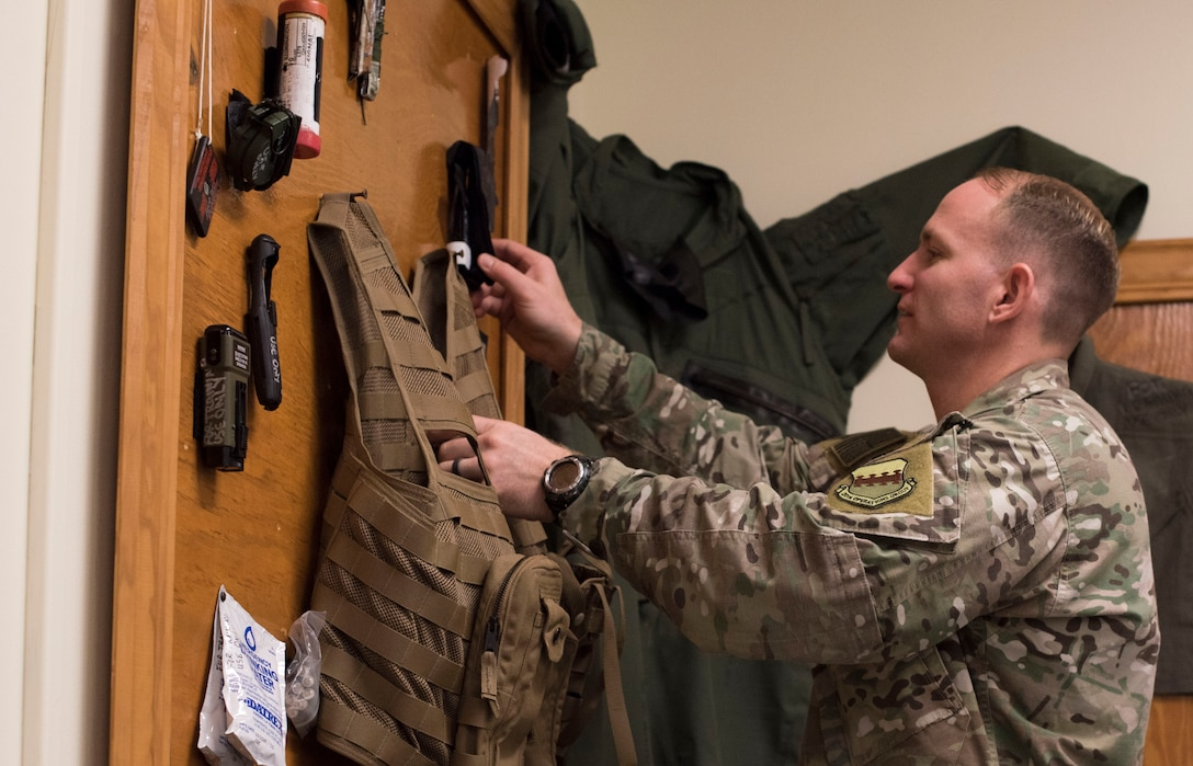 U.S. Air Force Tech. Sgt. David Jones, 20th Operations Support Squadron noncommissioned officer in charge of operations, weapons and tactics, looks at training gear in a classroom at Shaw Air Force Base, South Carolina, Oct. 21, 2019.