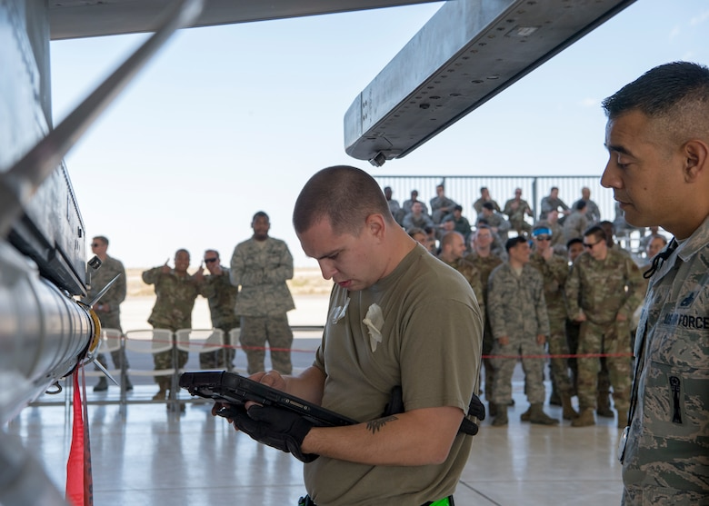 Staff Sgt. Edward Spidle, 311th Aircraft Maintenance Unit weapons load crew chief, ensures all equipment is accounted for during a load competition, Oct. 28, 2019, on Holloman Air Force Base, N.M. Two F-16 Vipers and two MQ-9 Reapers were used to test the loading skills of 12 Airmen during the 2019 third quarter load competition. (U.S. Air Force photo by Airman 1st Class Autumn Vogt)