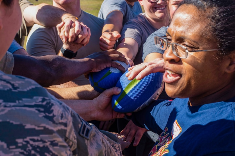 U.S. Air Force Master Sgt. Ashley Taylor, a 20th Security Forces Squadron flight chief, huddles in with her flight at the conclusion of a game at Shaw Air Force Base, South Carolina, Oct. 17, 2019.