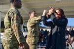 Elena Khovanskaya, DLA Troop Support Industrial Hardware purchasing agent (right), uses demonstrated techniques to remove a dummy knife from Air Force Staff Sgt. Jacob Sanchez, 87th Security Forces Phoenix Raven, as Staff Sgt. E-Quantay Mason, 87th SFS Phoenix Raven, looks on during an exhibition Oct. 23 at Joint Base McGuire-Dix-Lakehurst, N. J. The exhibition was part of a DLA Troop Support Academy joint base tour showcasing some of Troop Support's Warfighter customers.