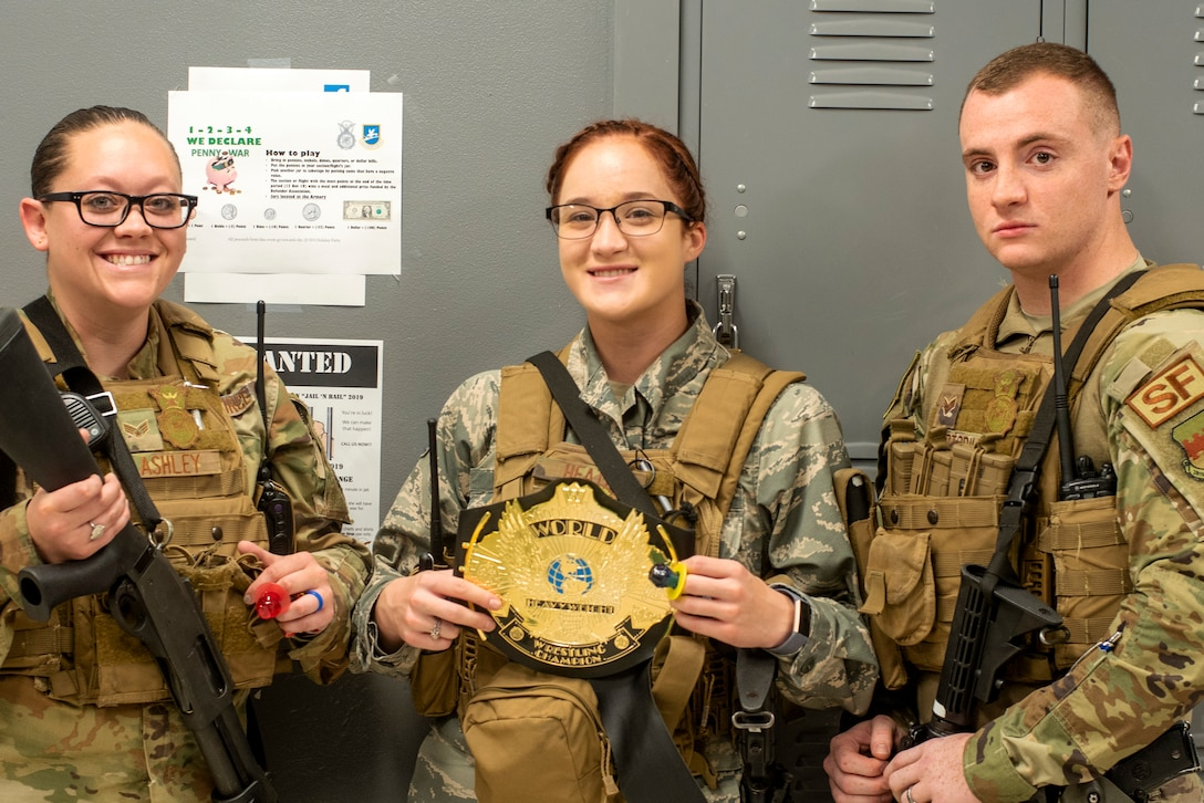 U.S. Air Force Senior Airman Meghan Lashley, left, Airman 1st Class Ireland Heath, 20th Security Forces Squadron (SFS) installation entry controllers and Senior Airman Vincent Cortorillo, a 20th SFS patrolman, smile with awards at Shaw Air Force Base, South Carolina, Oct. 25, 2019.